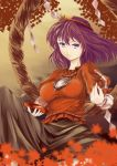 1girl blouse breasts brown_background f_kz knee_up leaf long_sleeves looking_at_viewer maple_leaf mirror puffy_sleeves purple_hair sakazuki shide shimenawa short_hair short_sleeves skirt solo touhou violet_eyes wind yasaka_kanako